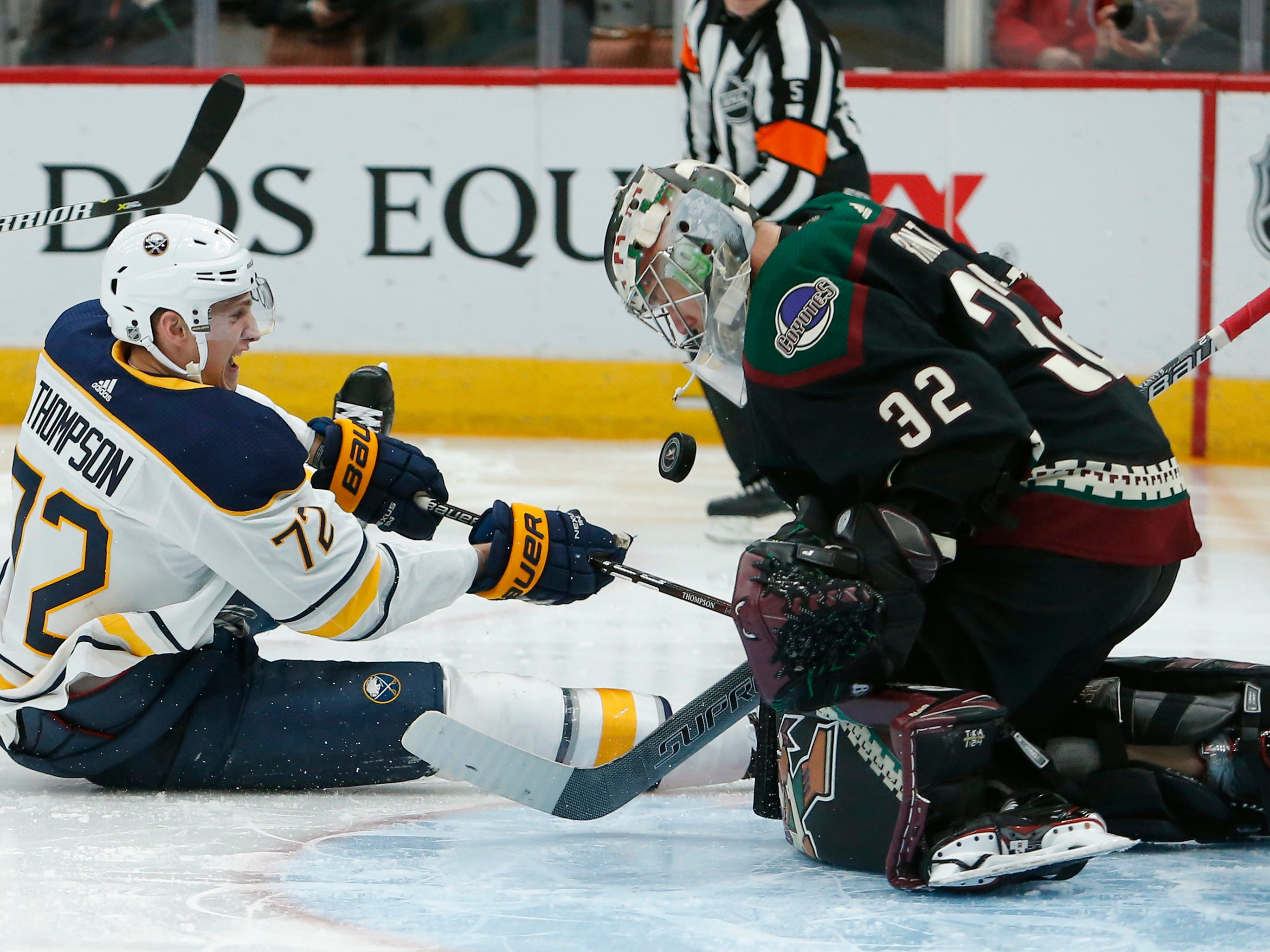 Arizona Coyotes goaltender Antti Raanta (32) makes the save on Buffalo Sabres center Tage Thompson during the third period of an NHL hockey game Saturday, Oct. 13, 2018, in Glendale, Ariz.