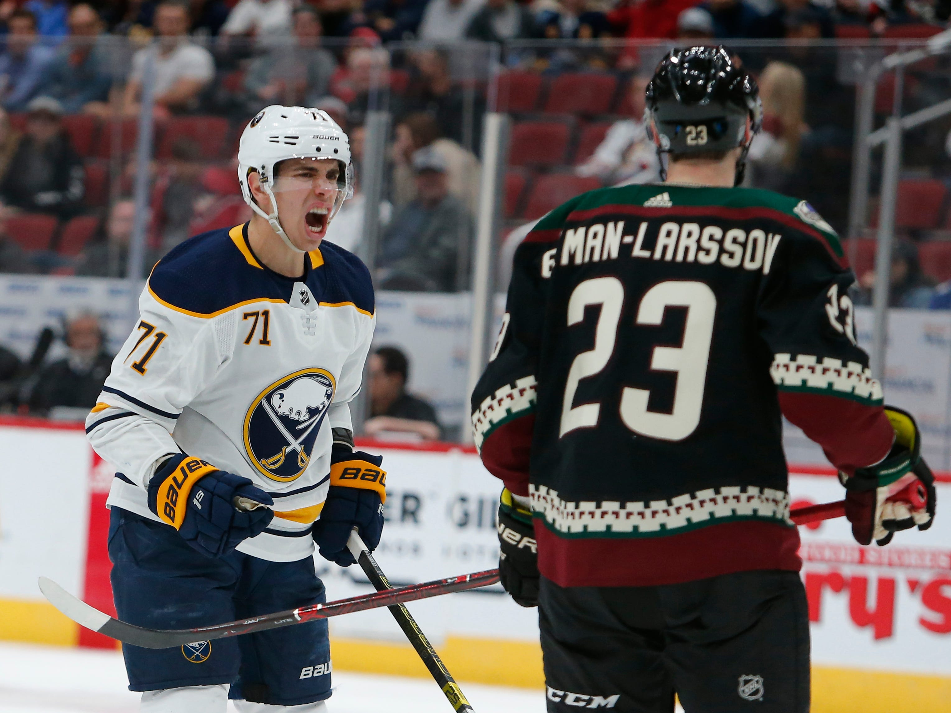 Buffalo Sabres left wing Evan Rodrigues (71) yells at Arizona Coyotes defenseman Oliver Ekman-Larsson after getting slashed during the third period during an NHL hockey game Saturday, Oct. 13, 2018, in Glendale, Ariz.