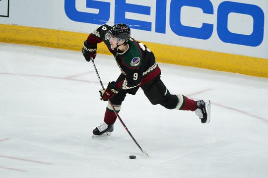 Oct 13, 2018; Glendale, AZ, USA; Arizona Coyotes center Clayton Keller (9) shoots during the second period against the Buffalo Sabres at Gila River Arena.
