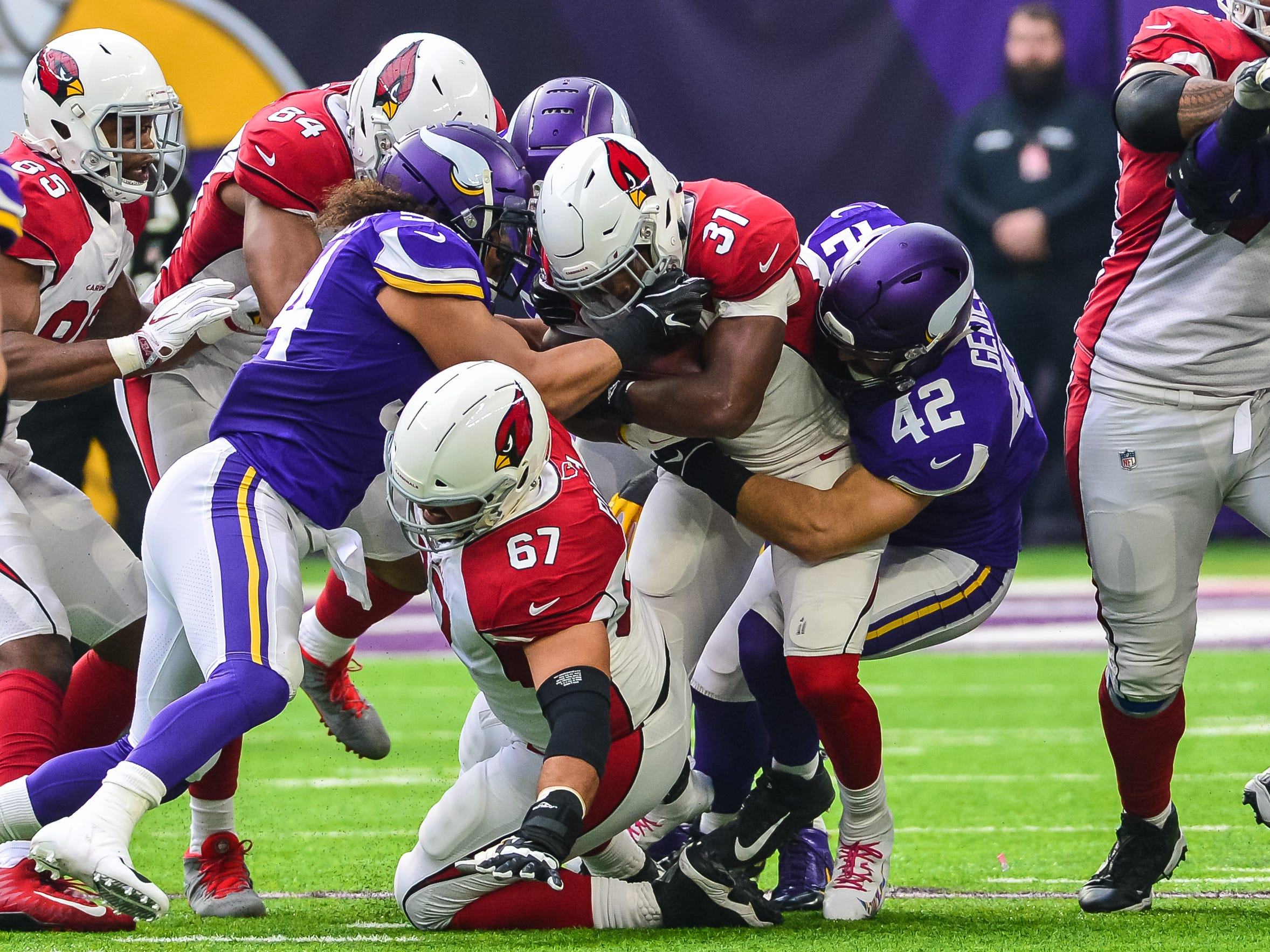 Oct 14, 2018; Minneapolis, MN, USA; Arizona Cardinals cornerback Patrick Peterson (21) is tackled by Minnesota Vikings linebacker Ben Gedeon (42) and linebacker Eric Kendricks (54) during the first quarter at U.S. Bank Stadium. Mandatory Credit: Jeffrey Becker-USA TODAY Sports