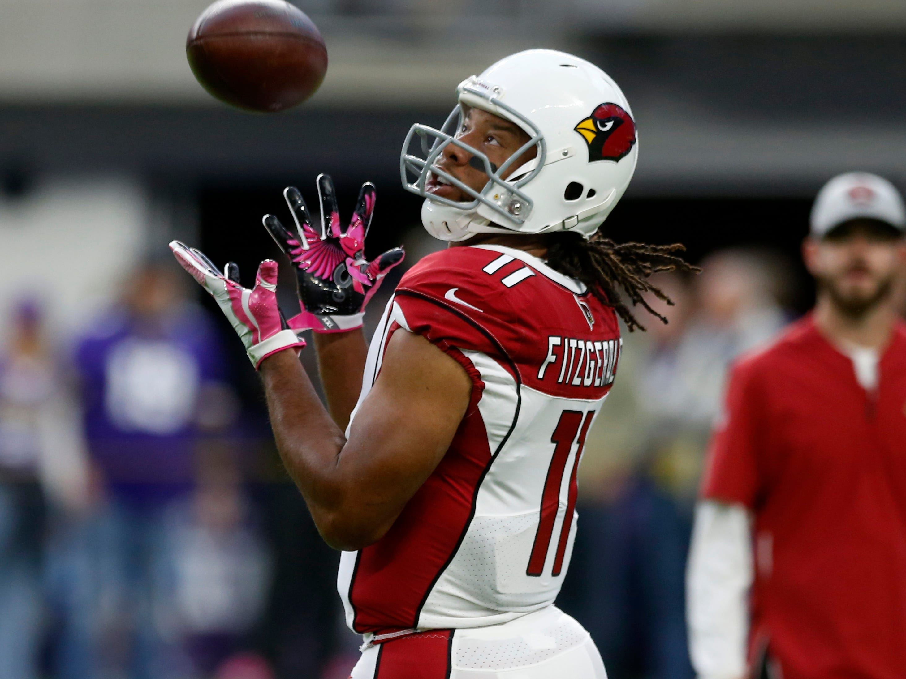 Arizona Cardinals wide receiver Larry Fitzgerald warms up before an NFL football game against the Minnesota Vikings, Sunday, Oct. 14, 2018, in Minneapolis. (AP Photo/Jim Mone)