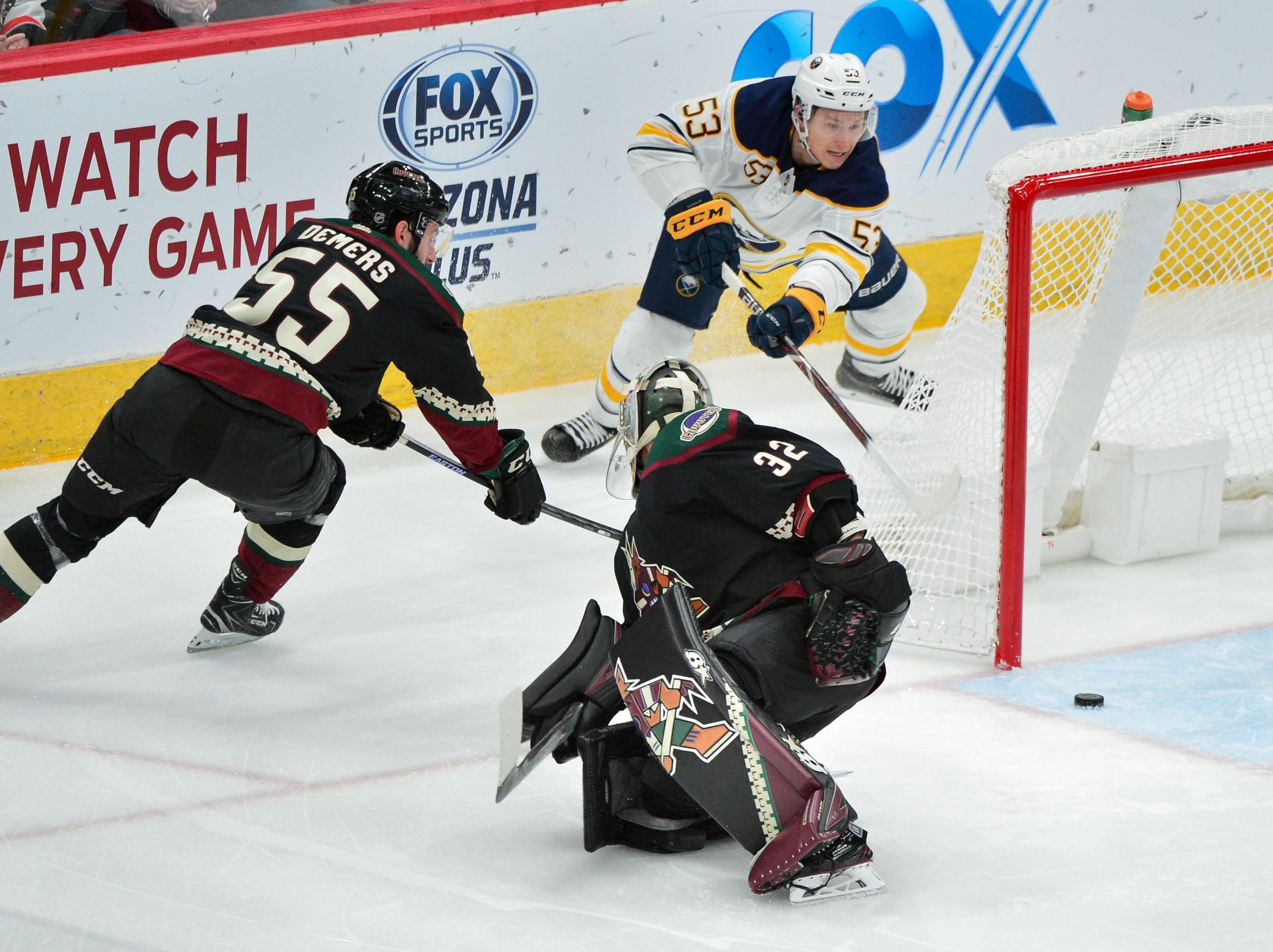 Oct 13, 2018; Glendale, AZ, USA; Buffalo Sabres left wing Jeff Skinner (53) passes to defenseman Rasmus Dahlin (not pictured) for an assist against Arizona Coyotes goaltender Antti Raanta (32) and defenseman Jason Demers (55) during the first period at Gila River Arena.