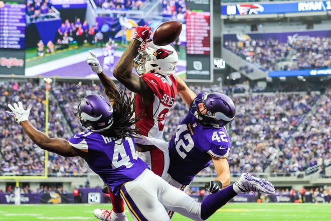 Oct 14, 2018; Minneapolis, MN, USA; Minnesota Vikings defensive back Anthony Harris (41) and linebacker Ben Gedeon (42) breakup a pass intended for Arizona Cardinals tight end Ricky Seals-Jones (86) during the second quarter at U.S. Bank Stadium. Mandatory Credit: Jeffrey Becker-USA TODAY Sports