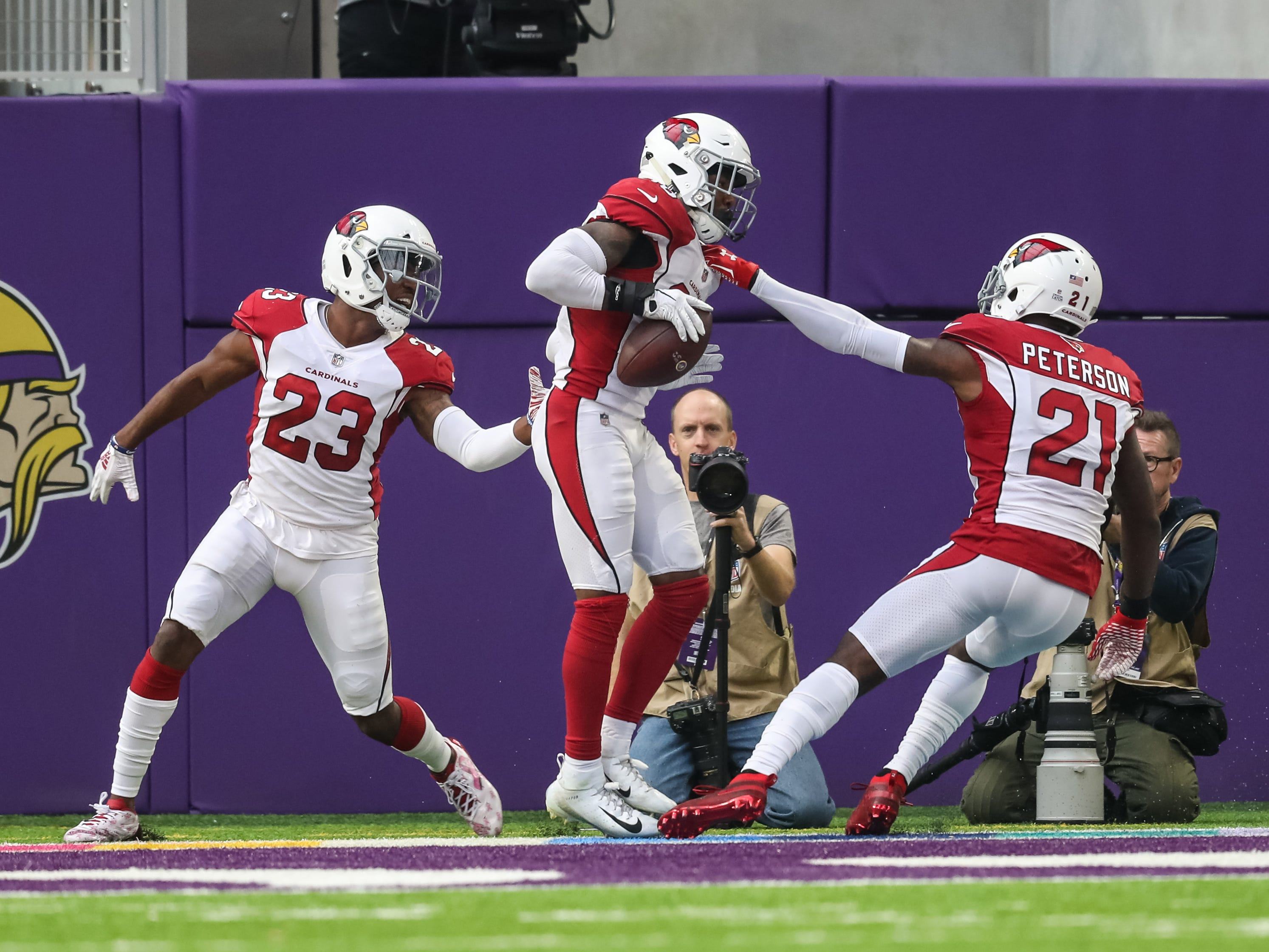 Oct 14, 2018; Minneapolis, MN, USA; Arizona Cardinals safety Budda Baker (36) celebrates his touchdown with cornerback Patrick Peterson (21) and cornerback Bene Benwikere (23) during the second quarter against the Minnesota Vikings at U.S. Bank Stadium. Mandatory Credit: Brace Hemmelgarn-USA TODAY Sports