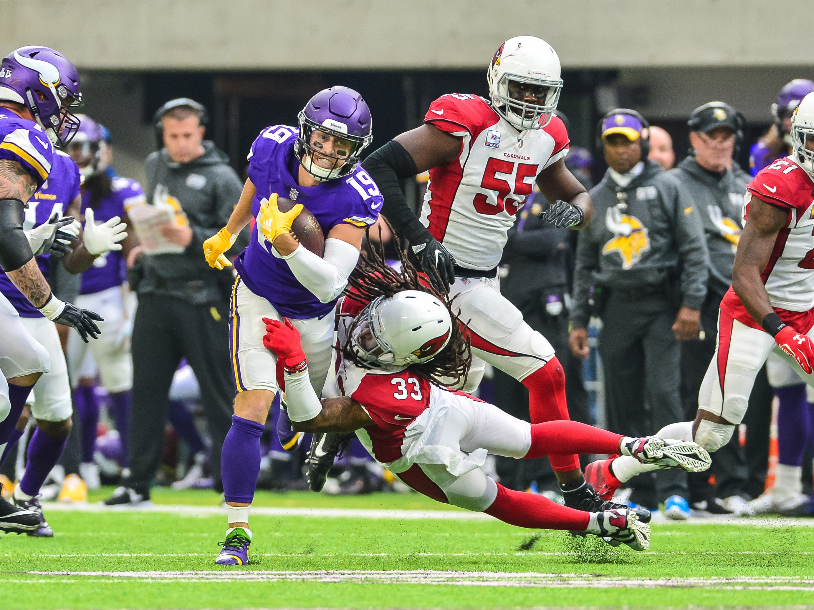 Oct 14, 2018; Minneapolis, MN, USA; Minnesota Vikings wide receiver Adam Thielen (19) is tackled by Arizona Cardinals defensive back Tre Boston (33) during the first quarter at U.S. Bank Stadium. Mandatory Credit: Jeffrey Becker-USA TODAY Sports