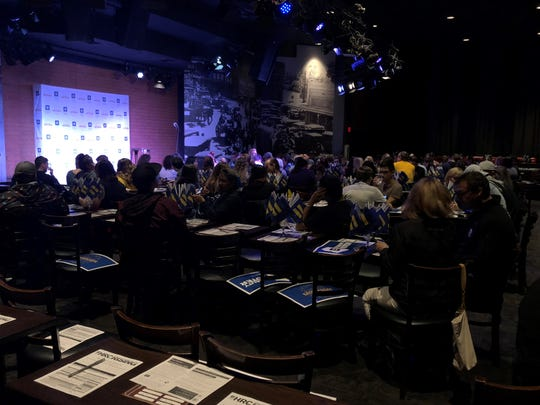 Voters find seats at the Glam Up the Midterms event in the Tempe Improv theater on Saturday, October 13, 2018.
