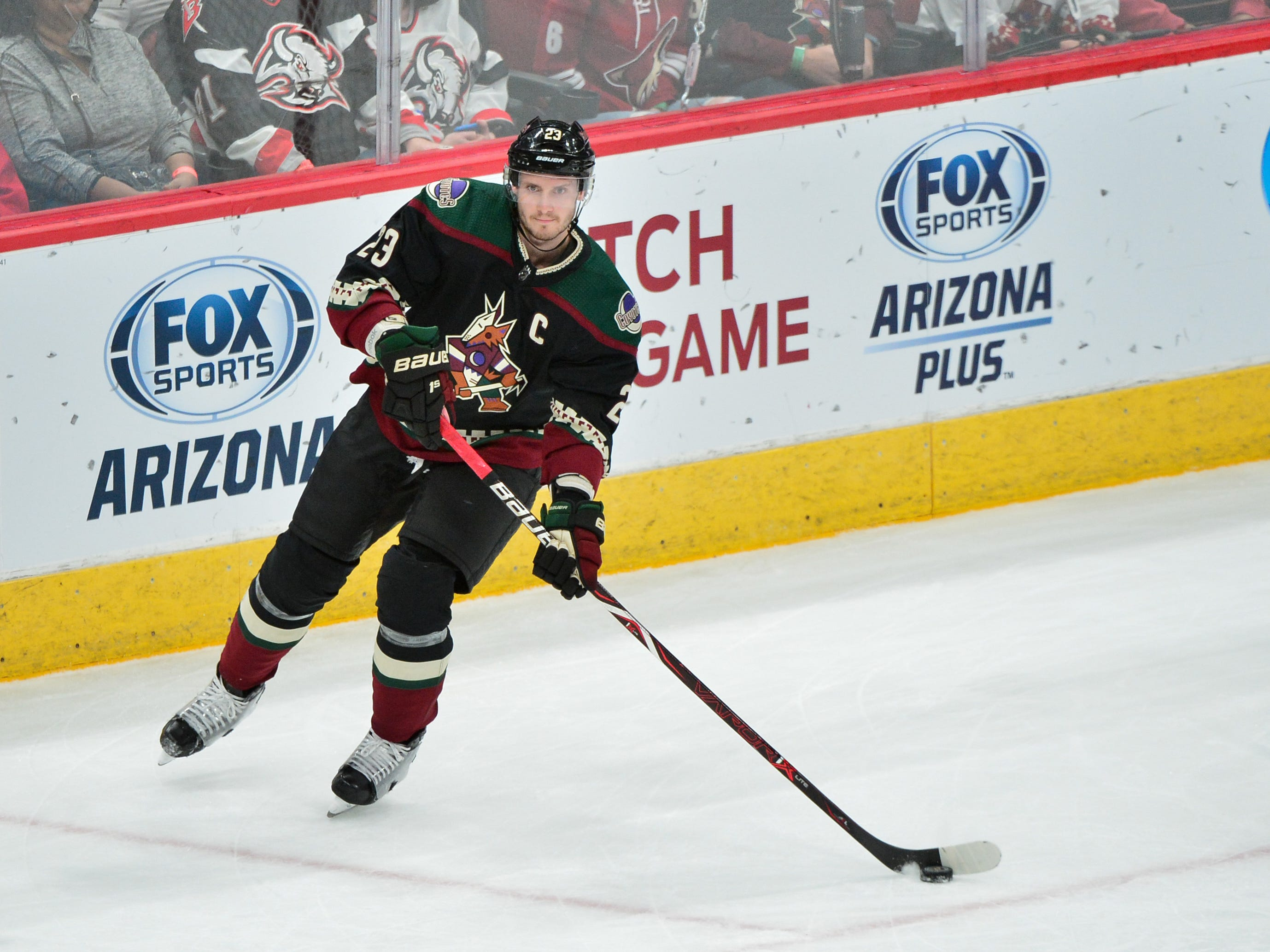 Oct 13, 2018; Glendale, AZ, USA; Arizona Coyotes defenseman Oliver Ekman-Larsson (23) carries the puck during the first period against the Buffalo Sabres at Gila River Arena.