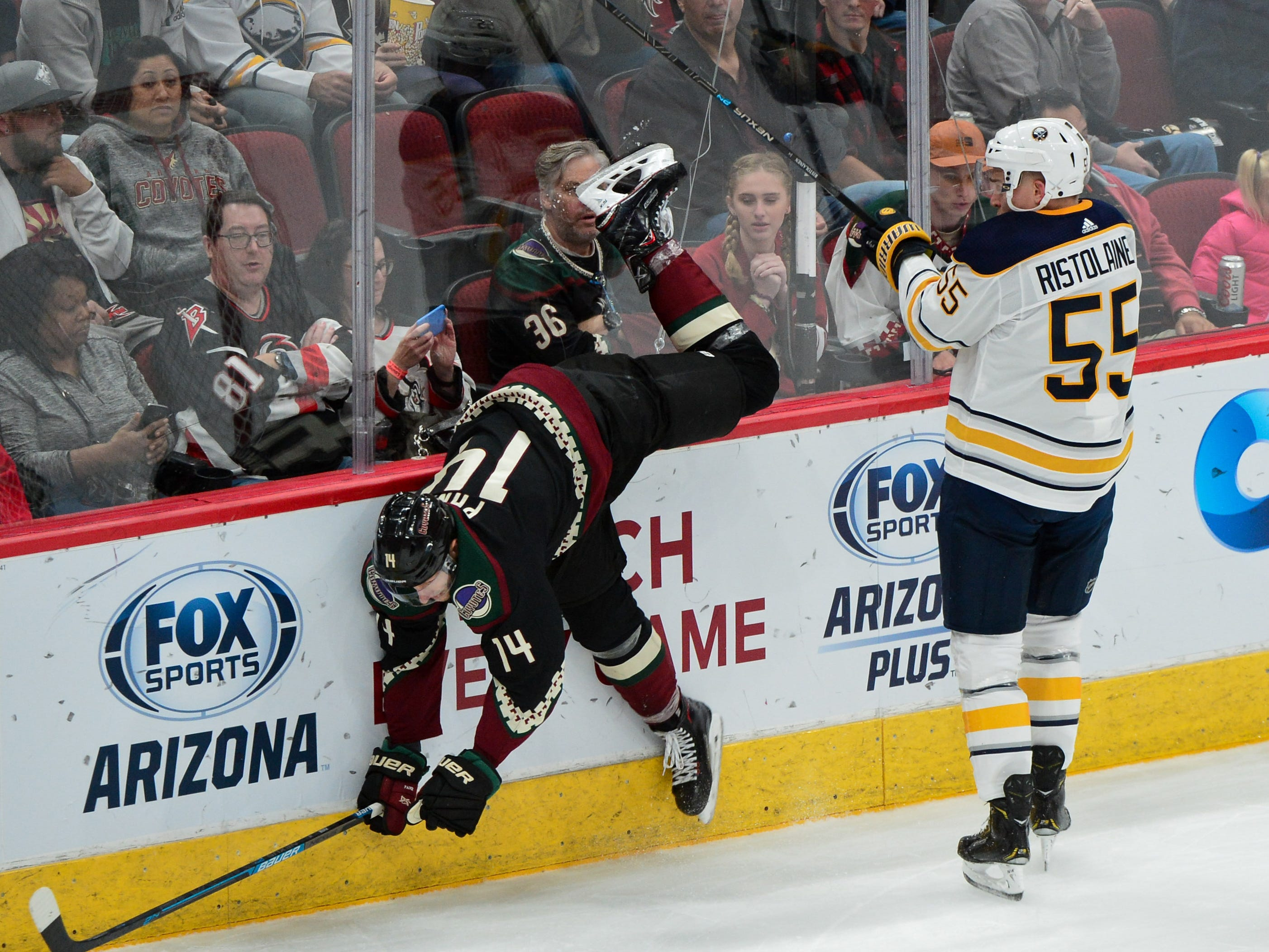 Oct 13, 2018; Glendale, AZ, USA; Buffalo Sabres defenseman Rasmus Ristolainen (55) checks Arizona Coyotes right wing Richard Panik (14) during the second period at Gila River Arena.