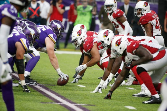 Players get set on the line of scrimmage during the second half of an NFL football game between the Minnesota Vikings and the Arizona Cardinals, Sunday, Oct. 14, 2018, in Minneapolis. The Vikings won 27-17.