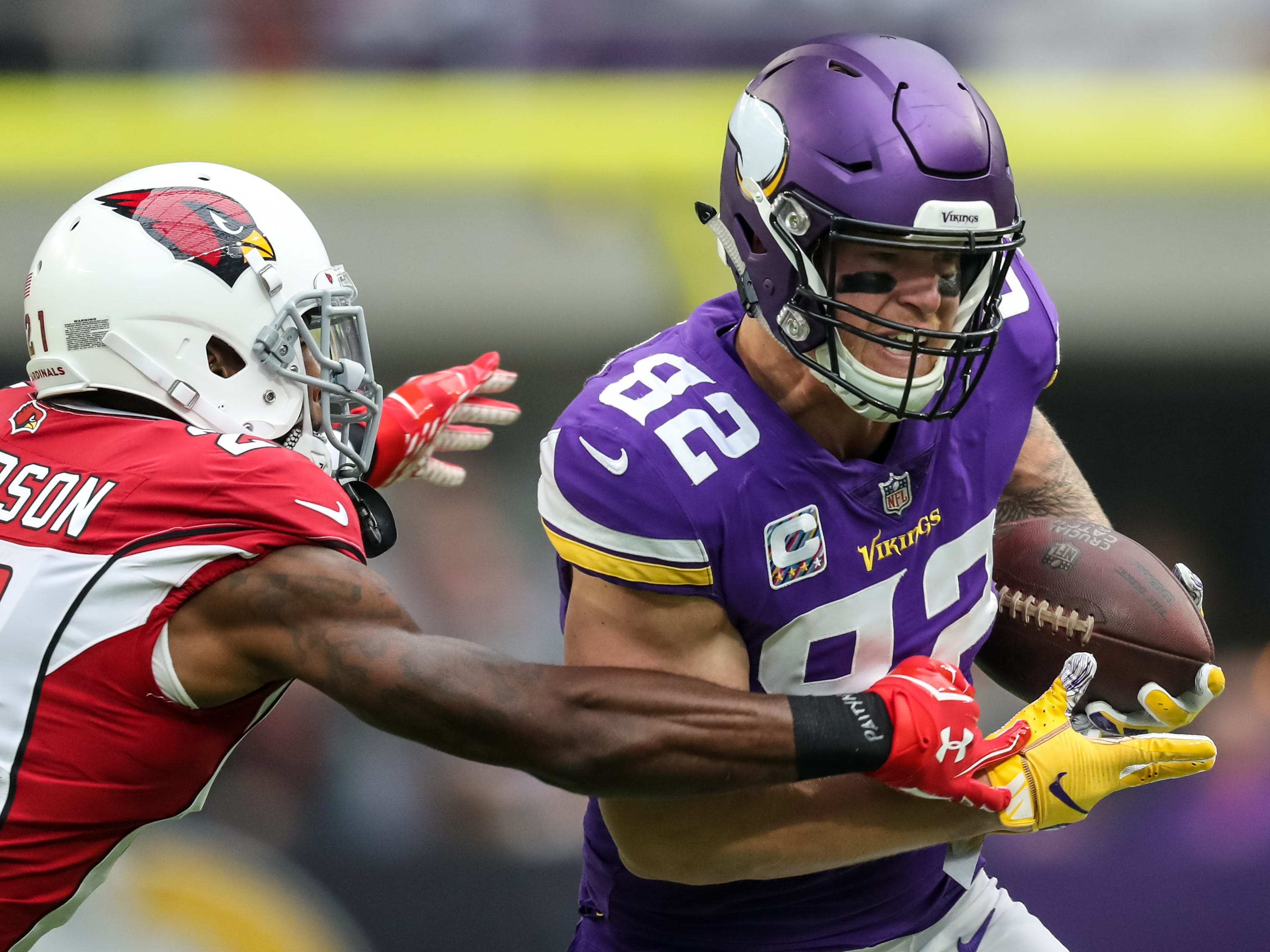 Oct 14, 2018; Minneapolis, MN, USA; Minnesota Vikings tight end Kyle Rudolph (82) is tackled by Arizona Cardinals cornerback Patrick Peterson (21) during the first quarter at U.S. Bank Stadium. Mandatory Credit: Brace Hemmelgarn-USA TODAY Sports