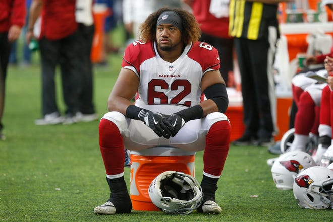 Arizona Cardinals center Daniel Munyer sits on the sideline during the first half of an NFL football game against the Minnesota Vikings, Sunday, Oct. 14, 2018, in Minneapolis. (AP Photo/Jim Mone)