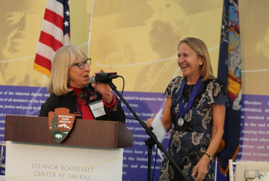 Dutchess Community College President Dr. Pamela R. Edington (right) shares a laugh with her presenter, DCC Board of Directors member Kip Bleakley O'Neill (left), at the Eleanor Roosevelt Val-Kill Award ceremony on Sunday. She was honored alongside five other people.