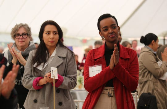 Marist College juniorsOrnella Mihigo (right) and Kathryn Rivera (left) clap during the Eleanor Roosevelt Val-Kill Award Ceremony on Sunday. Food was served and the recipients all gave speeches.