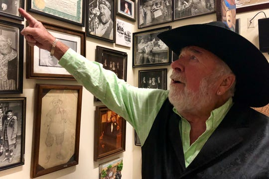 Ed Gotwalt, founder of Mister Ed's Elephant Museum and Candy Emporium, talks about several photos hanging on the wall in the Orrtanna store the afternoon of Sunday, Oct. 14, 2018.