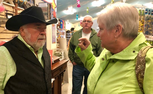 Ed Gotwalt, founder of Mister Ed's Elephant Museum and Candy Emporium, assists Marjie Houser, Hanover, with finding some candy in the Orrtanna store the afternoon of Sunday, Oct. 14.