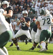Penn State quarterback Trace McSorley looks for an open receiver against Michigan State on Saturday. McSorley would find wideout K.J. Hamler in the end zone for a touchdown during the play and set a school career passing yards record in the process. Penn State lost to Michigan State, 21-17, on Saturday, October 13, 2018, at Beaver Stadium in University Park. Photos by Joe Rokita / JoeRokita.com