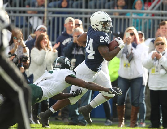 Penn State running back Miles Sanders is taken down by a shoestring tackle by Michigan State cornerback Justin Layne after a 78-yard run. Penn State lost to Michigan State, 21-17 ,on Saturday, October 13, 2018, at Beaver Stadium in University Park. Photos by Joe Rokita / JoeRokita.com