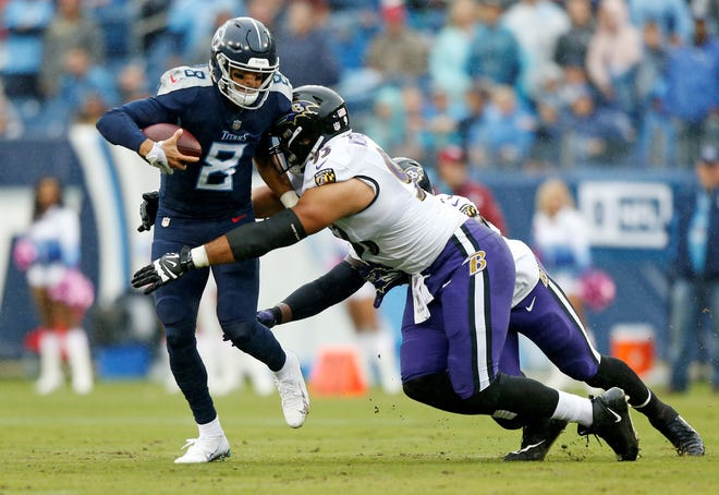 Tennessee Titans quarterback Marcus Mariota (8) is sacked by Baltimore Ravens defensive end Chris Wormley (93) for a 6-yard loss in the first half of an NFL football game Sunday, Oct. 14, 2018, in Nashville, Tenn. (AP Photo/Wade Payne)