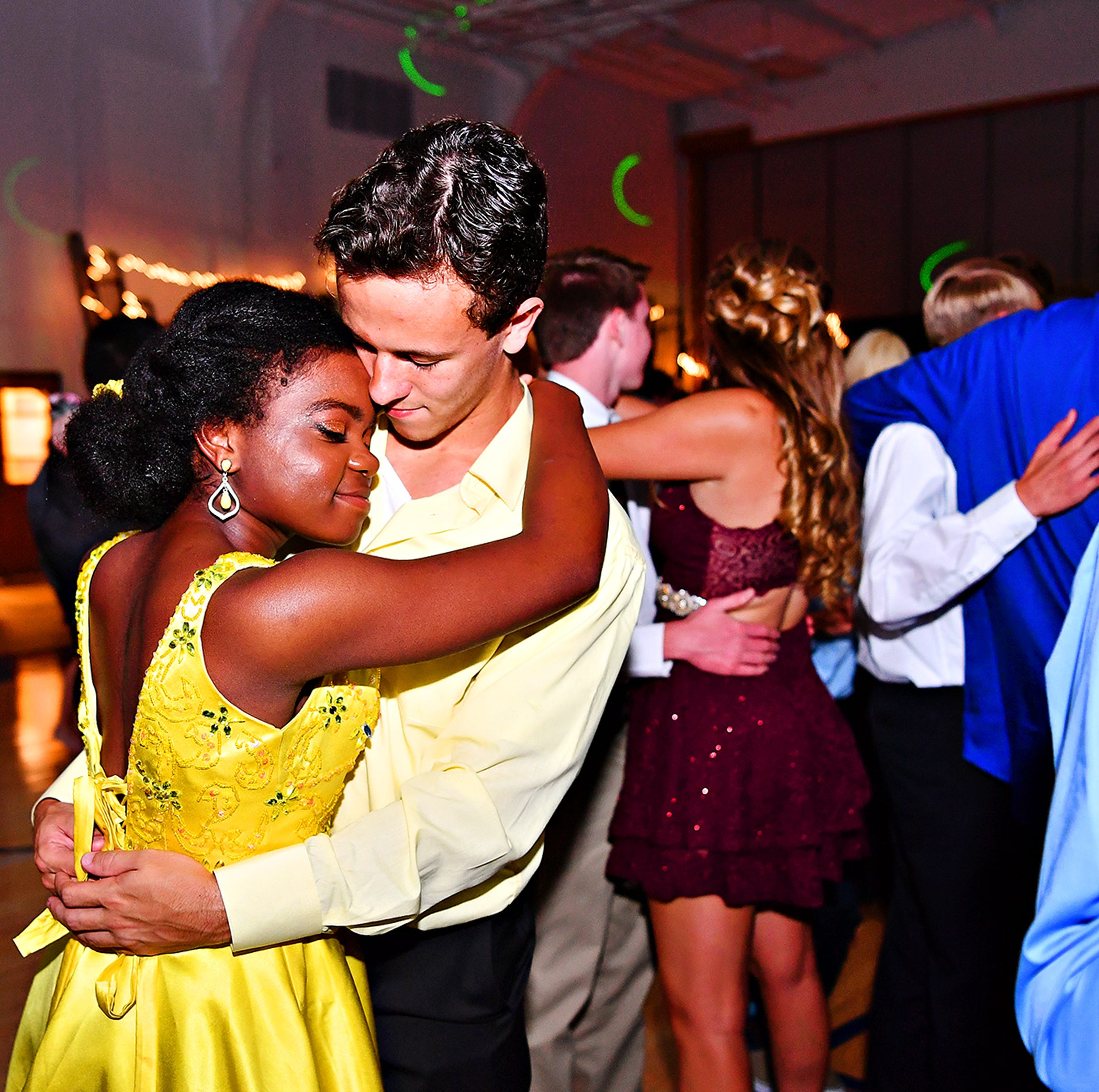 Students and their guests celebrate during the West York Area High School Homecoming Dance at West York Area High School in West Manchester Township, Saturday, Oct. 13, 2018. Dawn J. Sagert photo