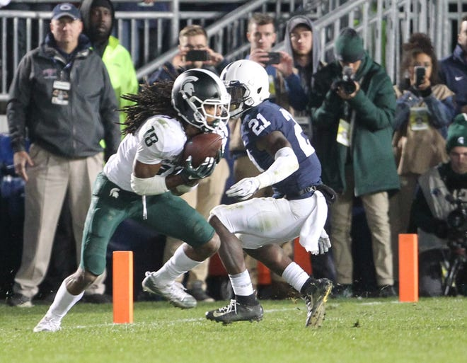 Michigan State wideout Felton Davis III catches a pass for a touchdown to take the lead late in the fourth quarter vs. Penn State. The Nittany Lions fell, 21-17, on Saturday, October 13, 2018, at Beaver Stadium in University Park. Photos by Joe Rokita / JoeRokita.com