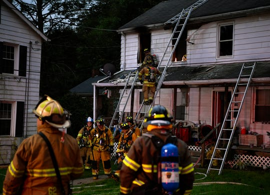 Fire fighters from several area departments saved a home in the 100 block of Church Street in Glen Rock, Sunday, Oct. 14, 2018. John A. Pavoncello photo