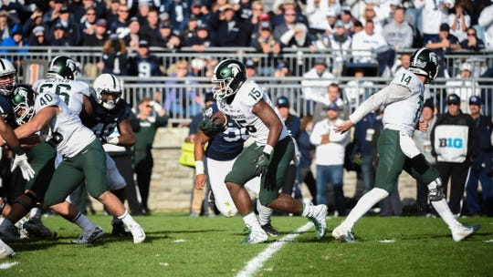 La'Darius Jefferson (15) looks for the hole during the Penn State Homecoming game against Michigan State, October 13, 2018. The Nittany Lions fell to the Spartans 17-21.