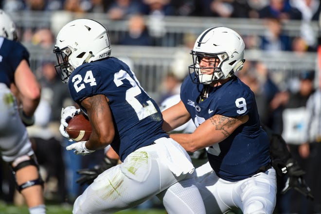 Trace McSorley (9) hands the ball off to Miles Sanders (24) during the Penn State Homecoming game against Michigan State, October 13, 2018. The Nittany Lions fell to the Spartans 17-21.