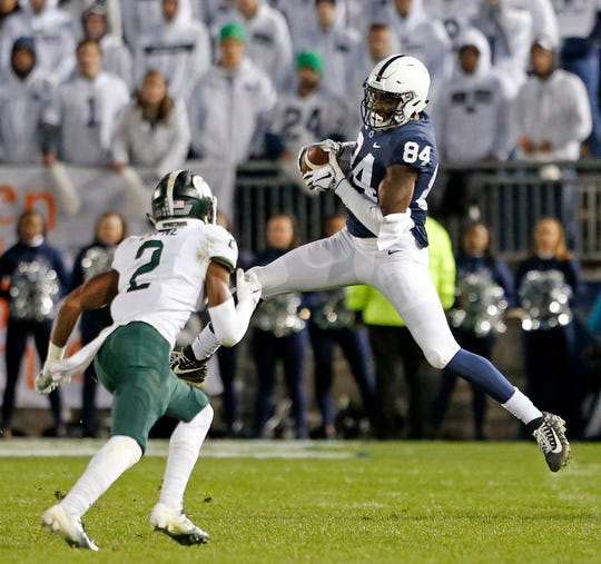 Penn State's Juwan Johnson (84) catches a pass in front of Michigan State's Justin Layne (2) during the second half of an NCAA college football game in State College, Pa., Saturday, Oct. 13, 2018.