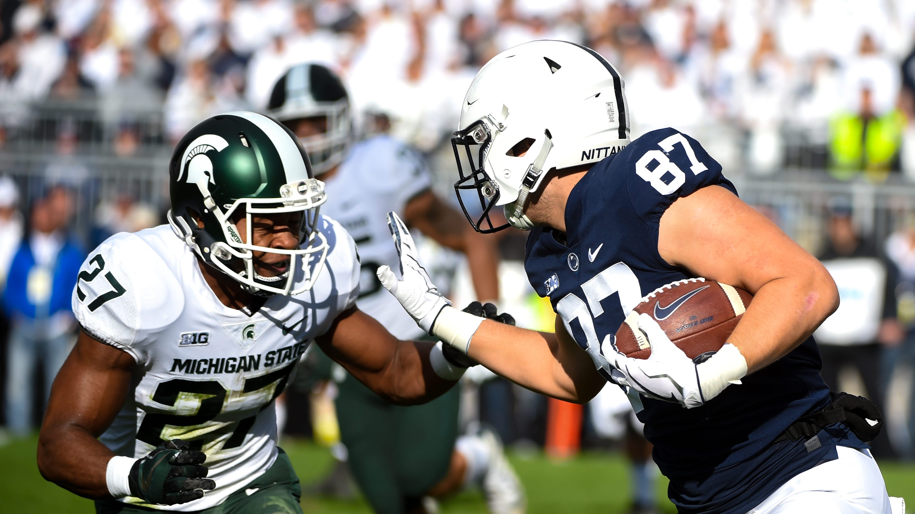 Penn State's Pat Freiermuth (87) looks to stiff-arm Michigan State's Jahz Watts (27), October 13, 2018. The Nittany Lions fell to the Spartans 17-21.