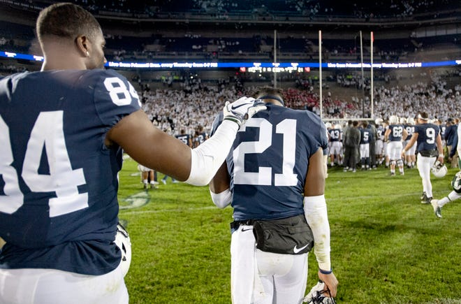 Penn State Juwan Johnson (84) pats cornerback Amani Oruwariye after a loss to Michigan State in an NCAA college football game Saturday, Oct. 13, 2018, in State College, Pa.