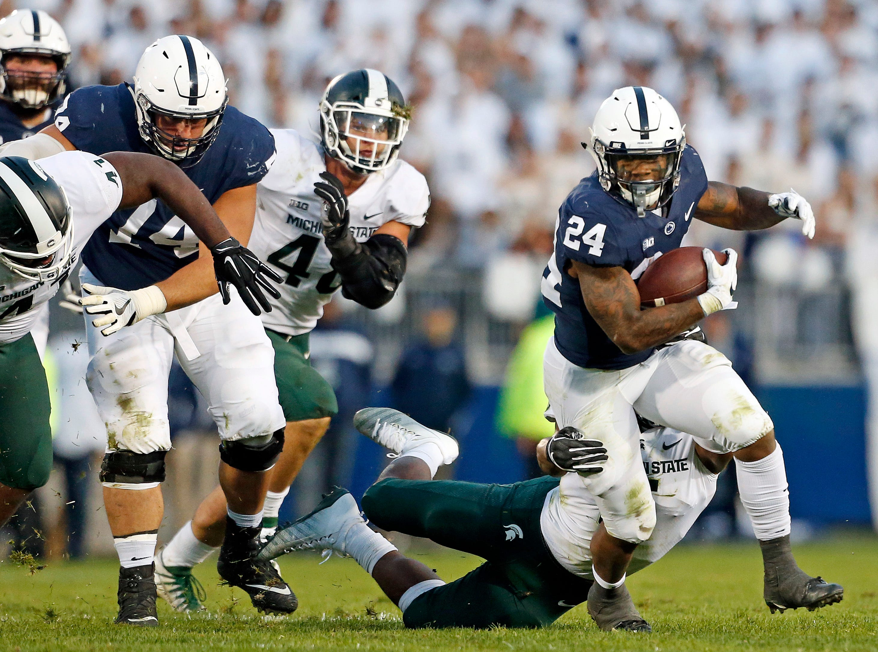 Penn State's Miles Sanders (24) runs the ball against Michigan State during the second half of an NCAA college football game in State College, Pa., Saturday, Oct. 13, 2018.