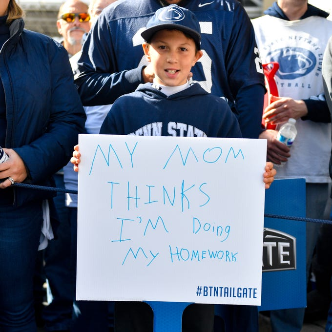 A young fan waits for the team to arrive at the Penn State Homecoming game against Michigan State, October 13, 2018. The Nittany Lions fell to the Spartans 17-21.