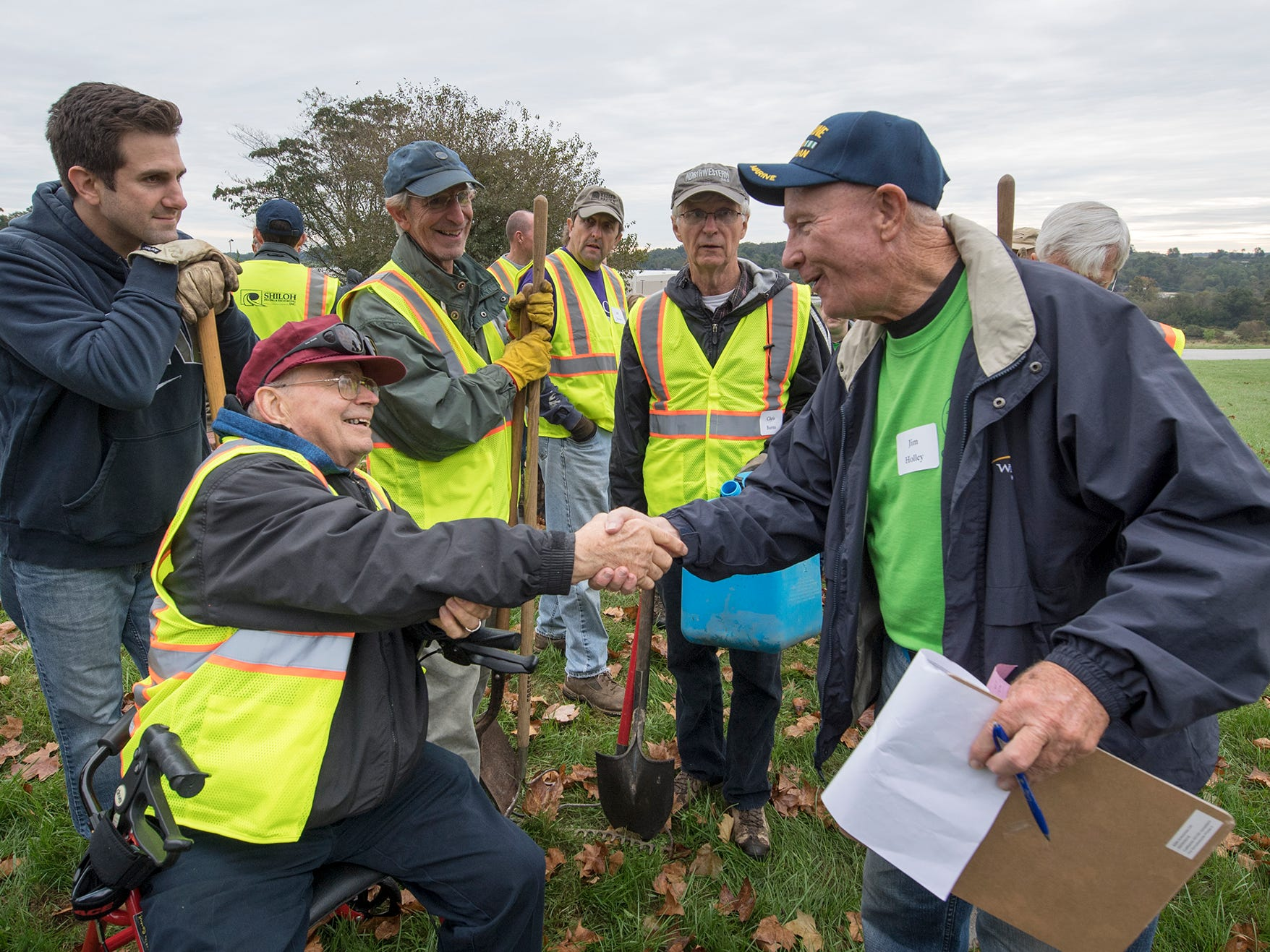 Paul Duryea, left, shakes hands with volunteer Jim Holley after the tree planting demonstation.