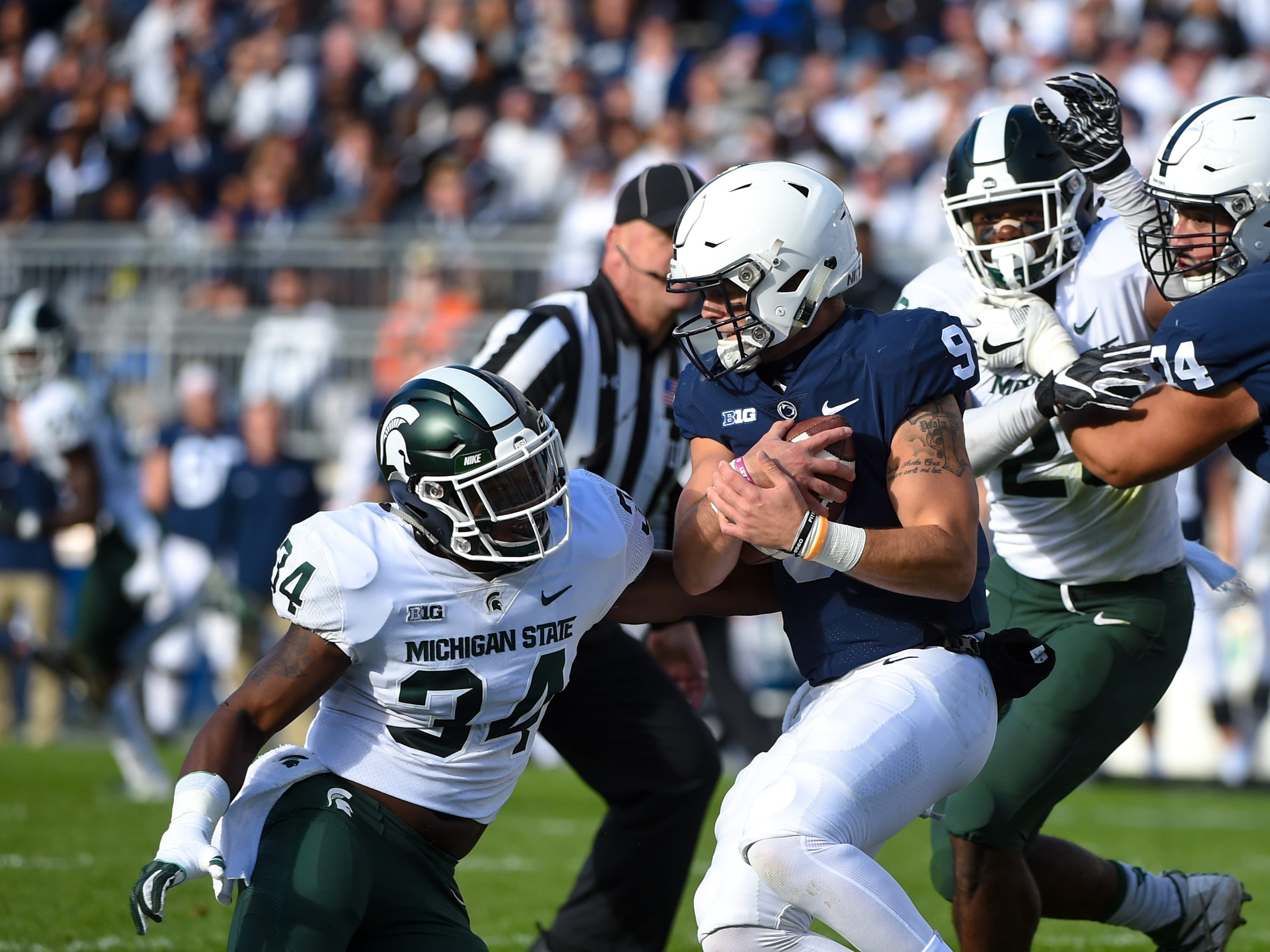 Trace McSorley (9) braces himself for the tackle during the Penn State Homecoming game against Michigan State, October 13, 2018. The Nittany Lions fell to the Spartans 17-21.