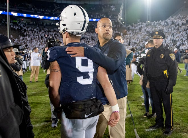 Penn State football coach James Franklin pats quarterback Trace McSorley (9) on the back as they walk off the field after a loss to Michigan State in an NCAA college football game Saturday, Oct. 13, 2018, in State College, Pa.