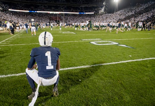 Penn State wide receiver KJ Hamler watches as Michigan State celebrates a win on Saturday, Oct. 13, 2018, in an NCAA college football game Saturday, Oct. 13, 2018, in State College, Pa.