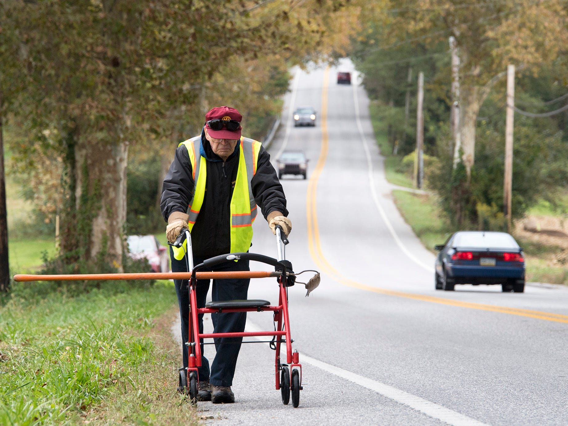 Paul Duryea walks up the Susquehanna Trail to help plant trees. Behind him is one of the original trees planted in 1920 on the Road of Remembrance Veterans Memorial.