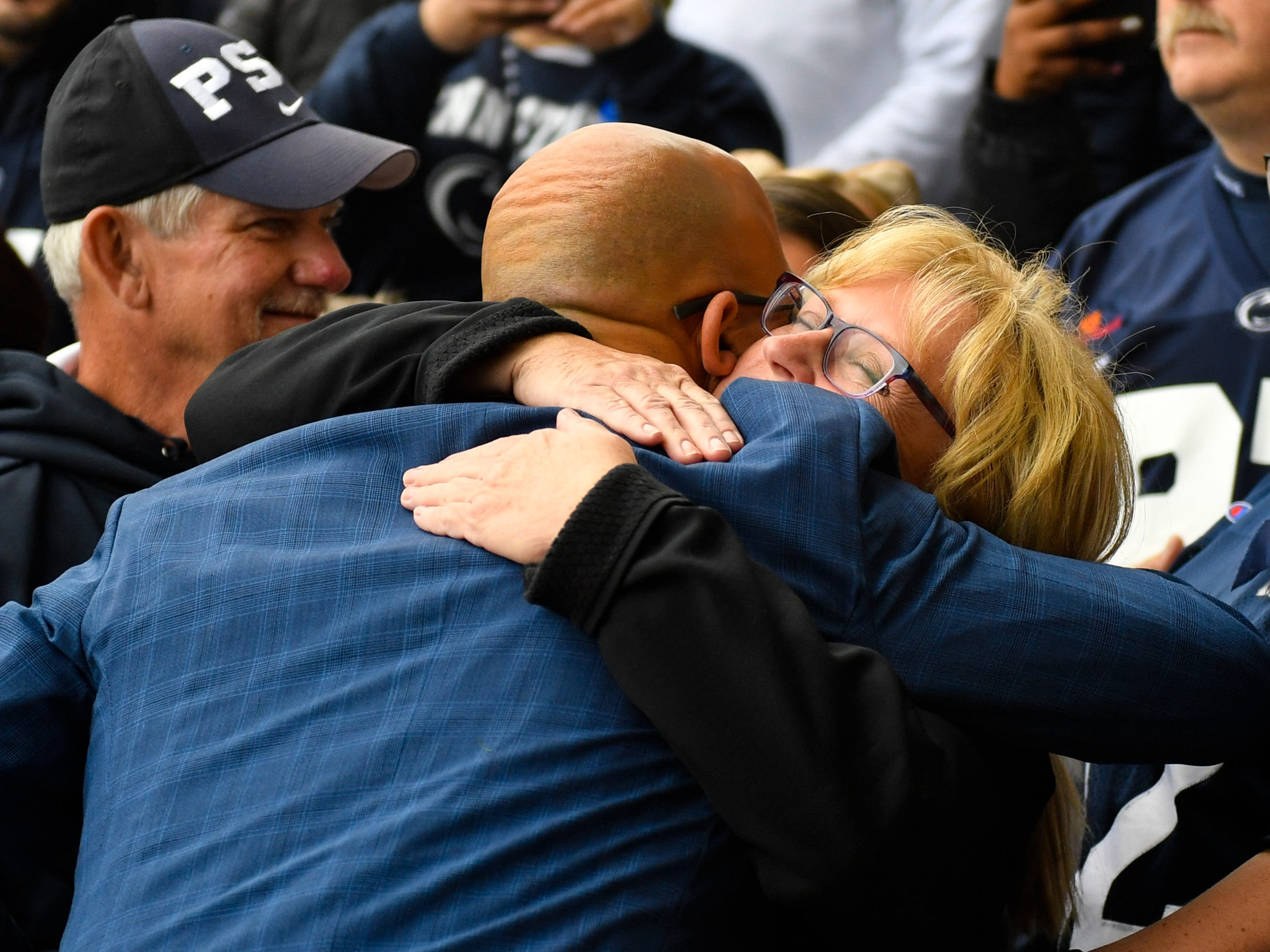 James Franklin hugs all parents in sight as he enters the stadium before the Penn State Homecoming game against Michigan State, October 13, 2018. The Nittany Lions fell to the Spartans 17-21.