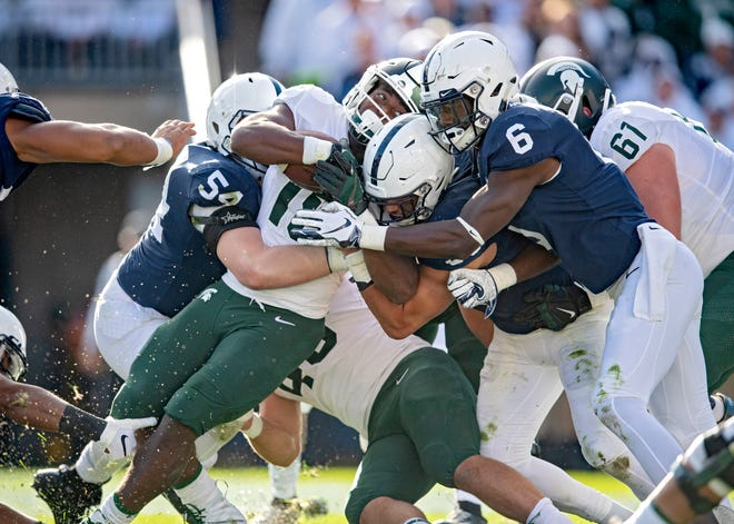Michigan State running back La'Darius Jefferson pushes though a pack of Penn State defenders for a touchdown during an NCAA college football game Saturday, Oct. 13, 2018, in State College, Pa.