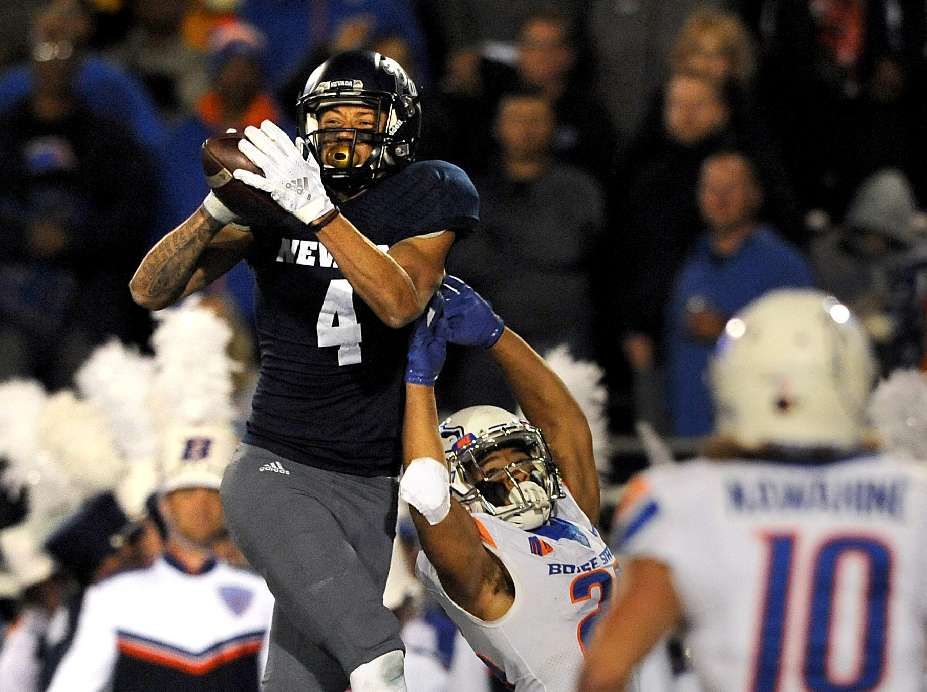 Nevada's Elijah Cooks makes a catch for a touchdown  while taking on Boise St. during their football game at Mackay Stadium in Reno on Oct. 13, 2018.