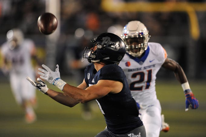 Nevada's McLane Mannix (1) hauls in a long pass while taking on Boise St. during their football game at Mackay Stadium in Reno on Oct. 13, 2018.