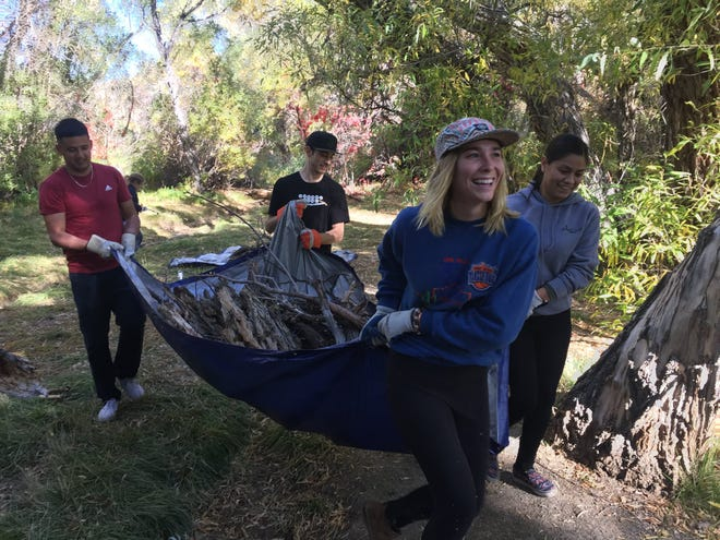 Volunteers remove debris during the Truckee River Cleanup on Saturday, Oct. 13.