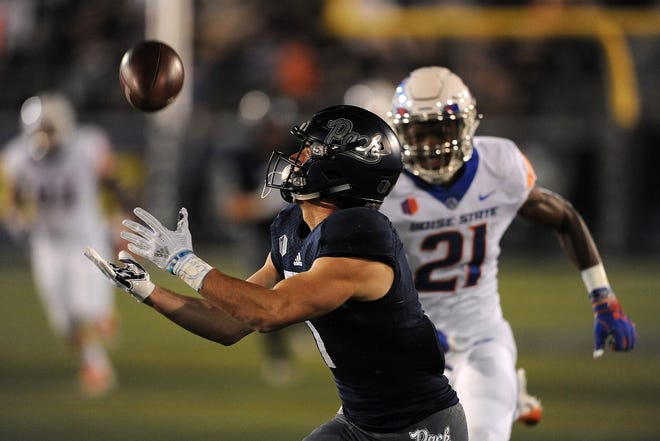 Nevada's McLane Mannix hauls in a long pass against Boise State on Saturday night at Mackay Stadium.