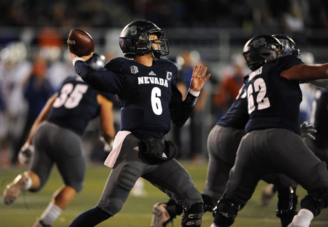 Nevada's Ty Gangi throws against Boise State. The Nevada quarterback is one of the 17 seniors the team will honor before Saturday's game against Colorado State.