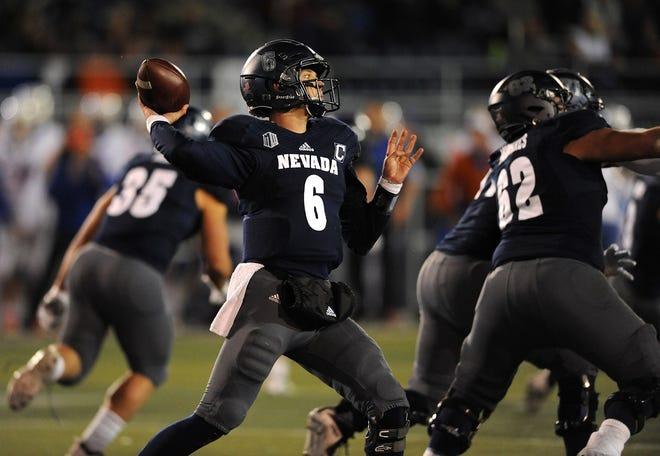 Nevada's Ty Gangi (6) throws against Boise State on Saturday night at Mackay Stadium.