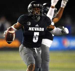 Nevada's Dameon Baber (5) celebrates a first-half interception against Boise State on Saturday night.