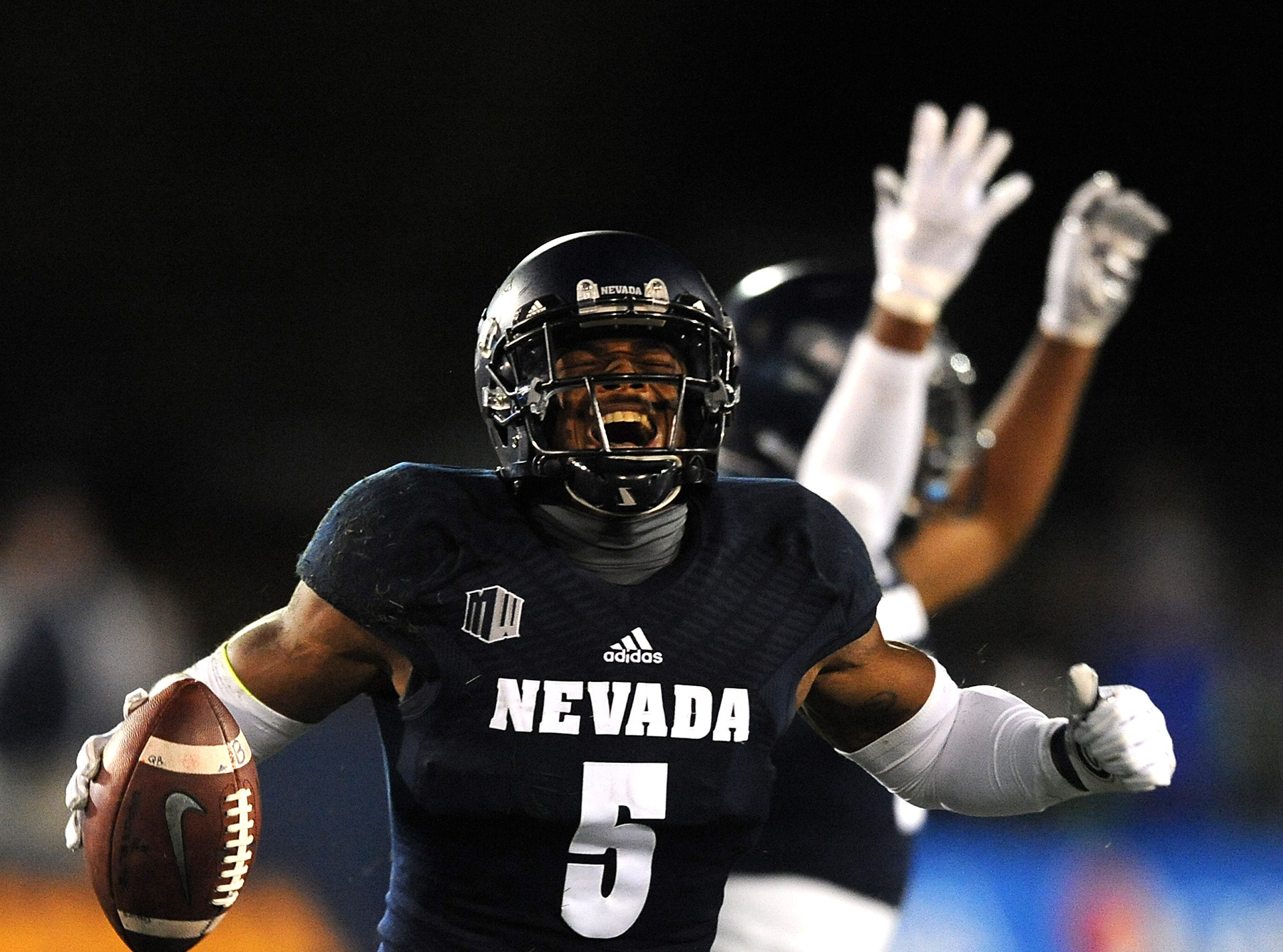 Nevada's Dameon Baber (5) celebrates a first half interception while taking on Boise St. during their football game at Mackay Stadium in Reno on Oct. 13, 2018.