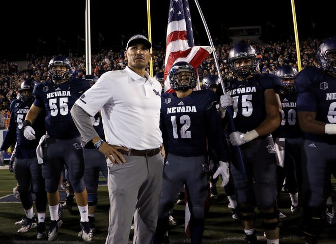 Nevada head coach Jay Norvell prepares to lead his team against Boise St. at Mackay Stadium in Reno on Oct. 13, 2018.