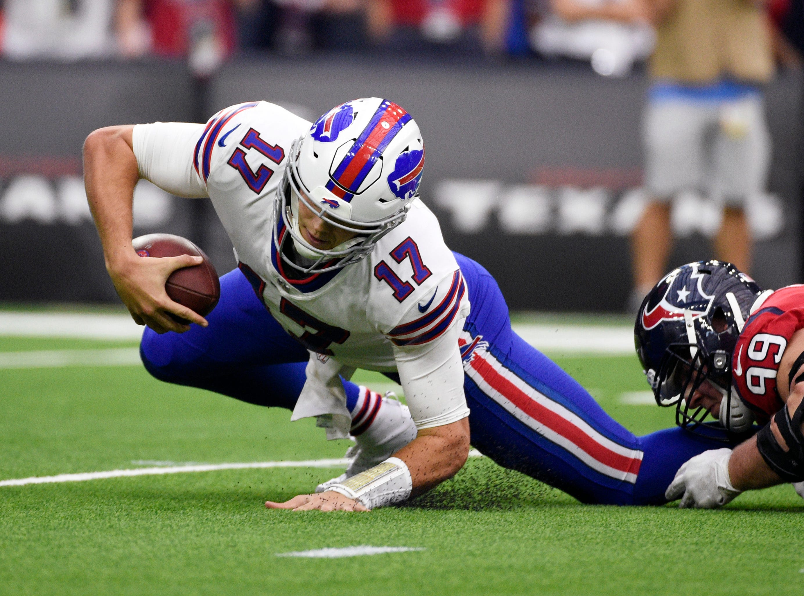Buffalo Bills quarterback Josh Allen (17) is sacked by Houston Texans defensive end J.J. Watt (99) during the first quarter of an NFL football game, Sunday, Oct. 14, 2018, in Houston. (AP Photo/Eric Christian Smith)