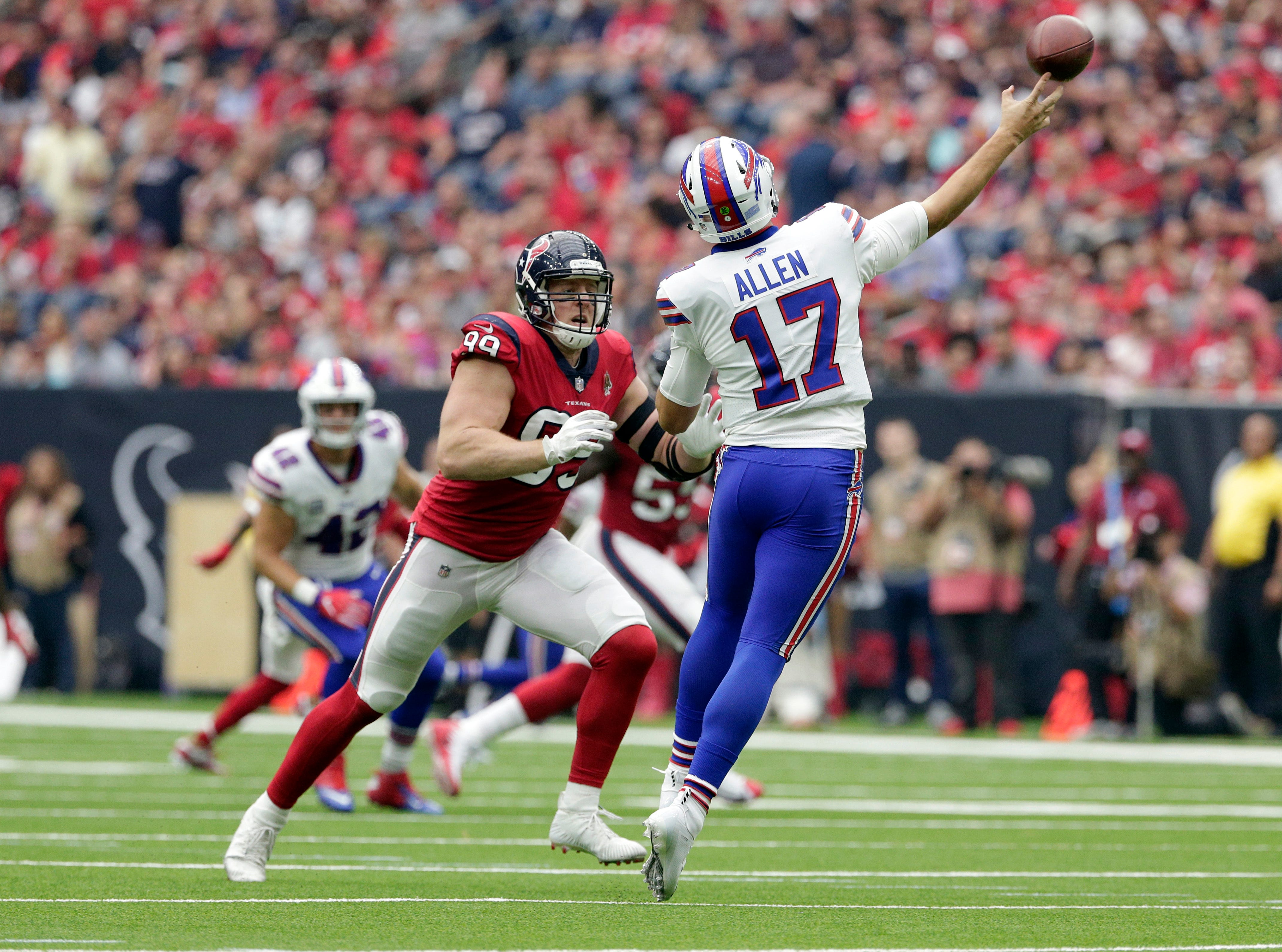 Buffalo Bills quarterback Josh Allen (17) is pressured by Houston Texans defensive end J.J. Watt (99) as he throws during the first quarter of an NFL football game, Sunday, Oct. 14, 2018, in Houston. (AP Photo/Michael Wyke)